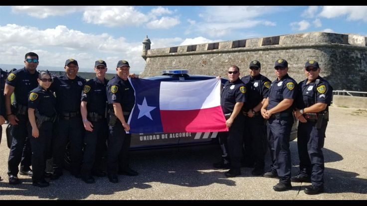 Houston police officers spend holiday working to rebuild...