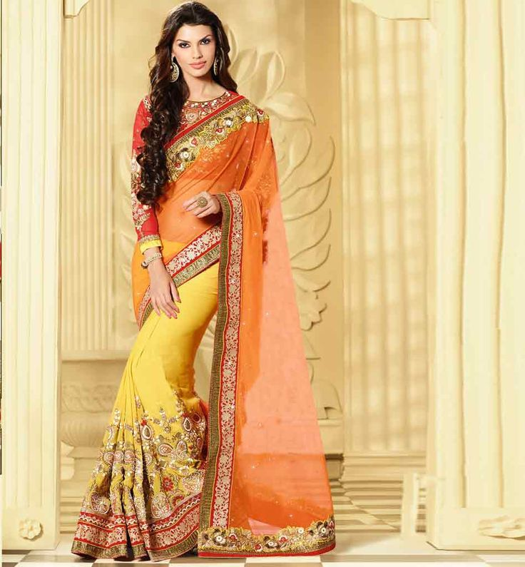 STUNNING WEDDING SARI RTHYP8508 Be the eye candy at the wedding functions with this Yellow & Orange color premium Net & Pure Georgette wedding wear sari. Exciting Zari, Resham embroidery with Stone work with Patch Butta & cut work lace with velvet border work done on the sari. This sari is teamed up with Red designer embroidered blouse fabric.