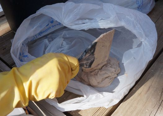 Make fake rocks with concrete and plastic shopping bags