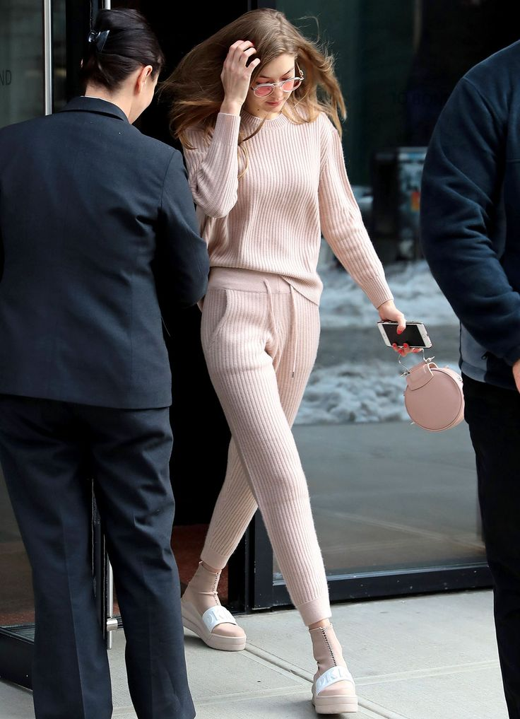 Hadid was seeing life through rose-colored glasses (literally) in N.Y.C., when she stepped out in this casual-chic, all-pink ensemble. The model paired a cozy cashmere sweatsuit with a round pink bag and DKNY platforms, providing the ultimate in off-duty dressing inspiration.