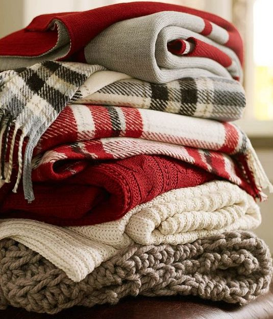 Sometimes fiber art is so simple, like a stack of plaid blankets, especially when some of the plaids are red!
