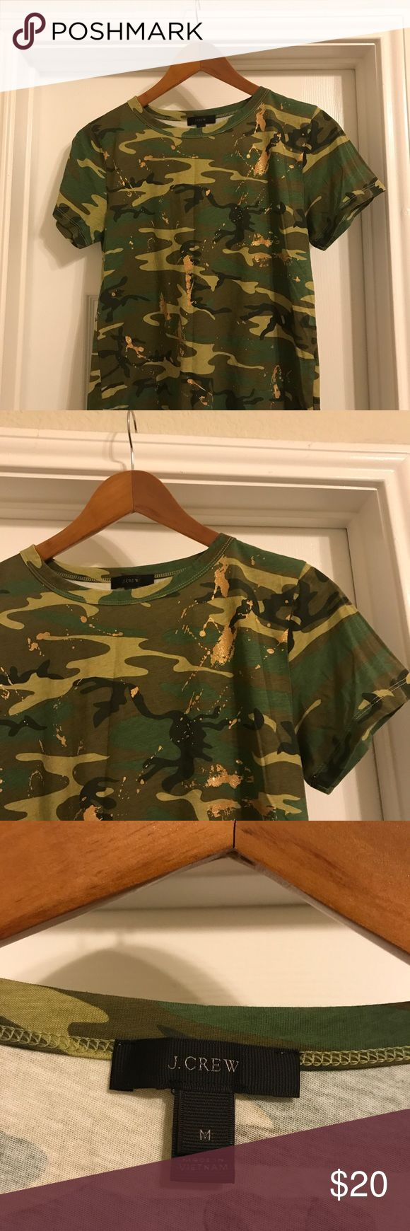 JCrew camo t-shirt JCew camo t-shirt! Cute gold splatter throughout t. Runs a bit small, so M is more similar to a S. Throw a utility jacket over and you are set! JCrew Tops Tees - Short Sleeve
