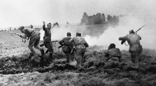 Soviet infantrymen charge out of a trench in Belorussia during Operation Bagration
