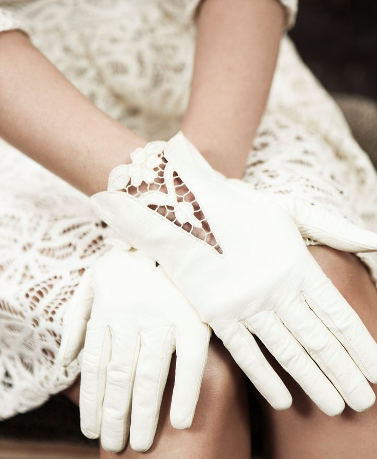 Vintage leather off-white bridal gloves with lace cut out detail.