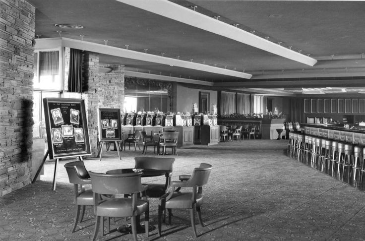 Have a look around the Flamingo Hotel. Las Vegas, 1947. Main lobby, lounge, casino and pool, as it looked in the Bugsy Seigel days. These are from the collection of Burton Frasher Sr photos at Pomona Public Library. No word on the identity of the guy playing peek-a-boo behind the check-in desk.