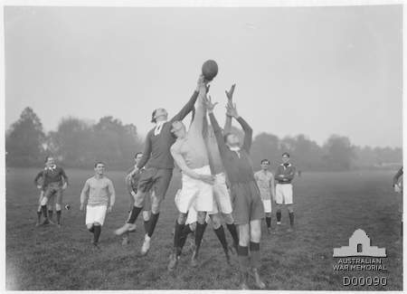 Soldiers playing Australian Rules football