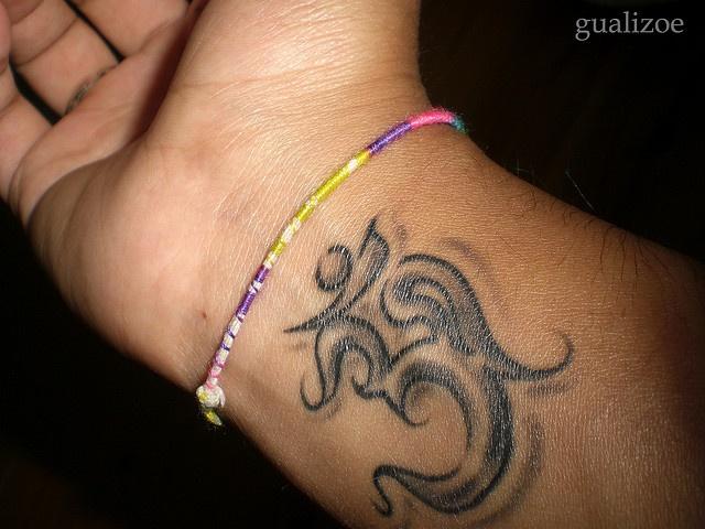 Ohm wrist tattoo by gualizoe, via Flickr