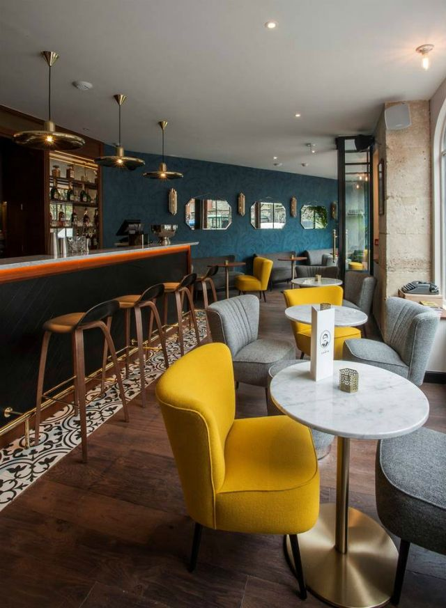 André Latin | The Trendiest Color Scheme Ideas For Restaurant Interiors | Restaurant Interior. Interior Design Inspiration. #restaurantinterior #restaurantinteriors #interiordesign Read more: https://www.brabbu.com/en/inspiration-and-ideas/trends/trendiest-color-scheme-ideas-restaurant-interiors