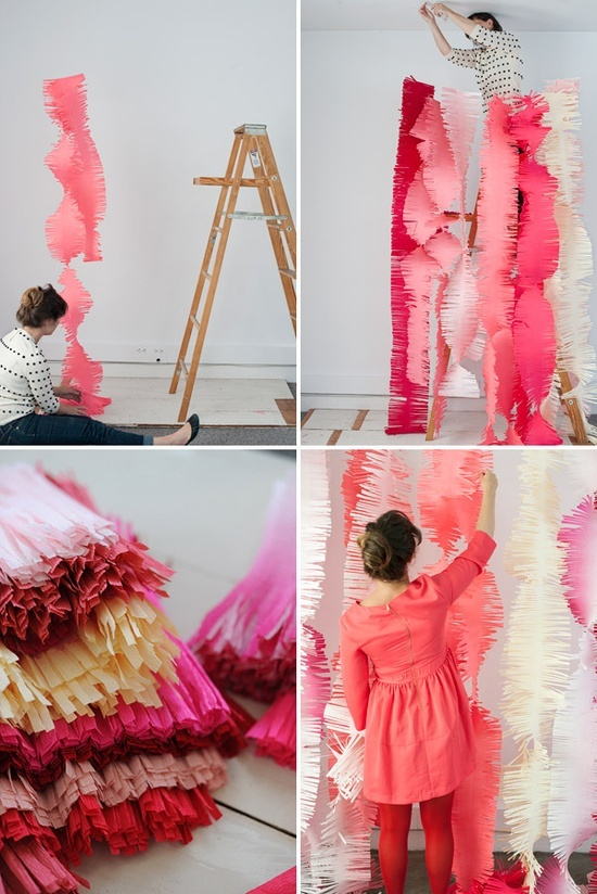 Fringe backdrop made of wide crepe, garlands like this could perhaps be used on other parts of the walls too?