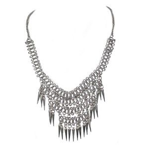 A silver piece tangled look, this necklace is made of a silver chain which gets thicker in the middle, from which hang silver spikes.