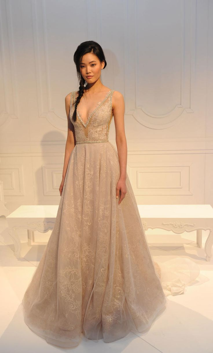 Extravagant champagne gown with plunging neckling | Galia Lahav Spring/Summer 2017 | https://www.theknot.com/content/galia-lahav-wedding-dresses-bridal-fashion-week-spring-summer-2017