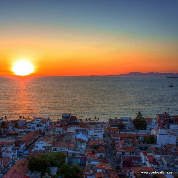 Puerto Vallarta sunset and the Marigalante from El Panorama Restaurant in PV.