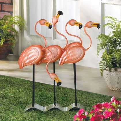 Sunny tropics and sandy beaches spring to mind at the very sight of this fabulous flock of bright pink flamingos. Metal-art statue is a colorful confection that no discerning decorator will want to do without!