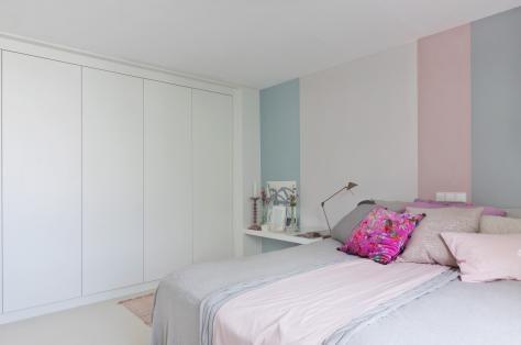 Slaapkamer witte kastenwand