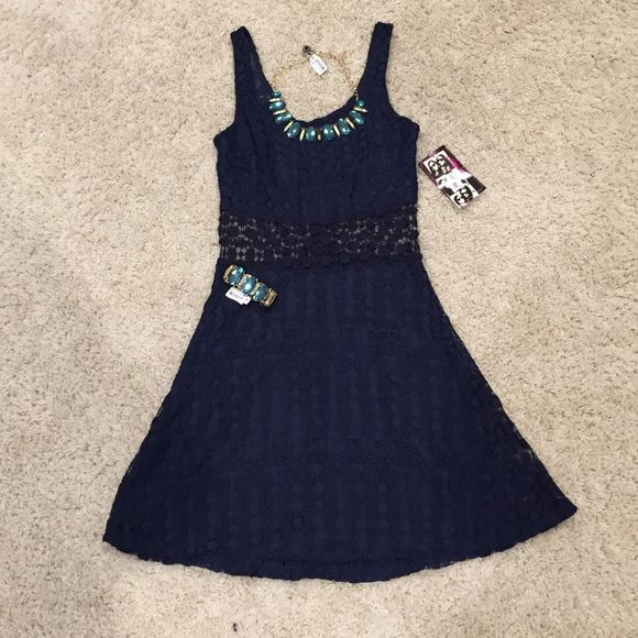 Beautiful Navy Blue Lace Dress Brand new with tags! See through in the mid section, underneath lining everywhere else! Love this dress! Perfect for spring or summer weather! Juniors 5 but fits a women's 4. Bought from Macy's Trixxi Dresses Mini