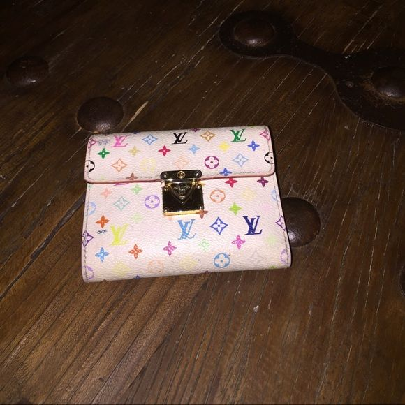 White Louis vouitton multicolor wallet Has been gently used. Has some marks from use, little tear by clasp. 100% authentic. Louis Vuitton Bags Wallets