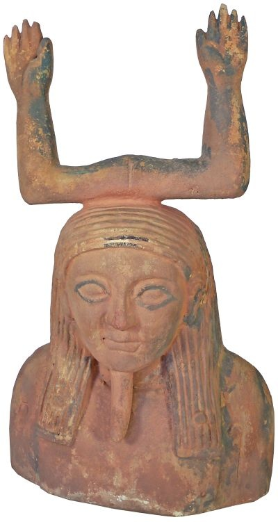 Carved wooden figure with the ka symbol to head a