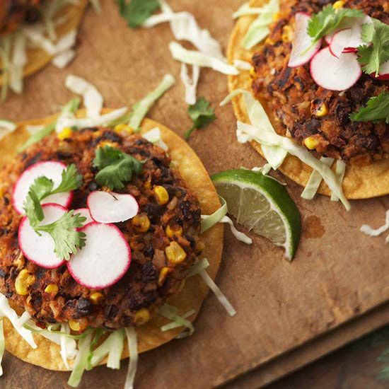 Black Bean Chipotle Burgers - Have these vegetarian burger patties on hand for any summer barbecue. They can easily be made in advance. Full of black beans, corn, and bottled salsa, these meatless burgers are as tasty as a traditional burger.