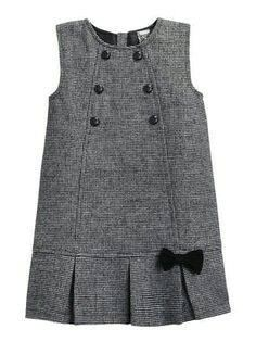 Dresd what about a cute little wool pinafore for a winter wedding flower girl. With tights & a white shirt & a fur trim cape