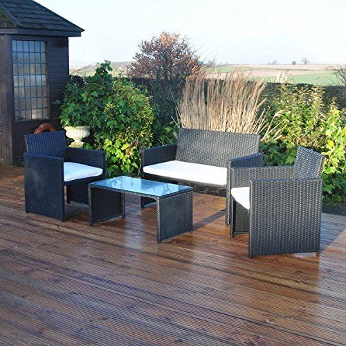 PIN 2 Wicker furniture is covered with plain cushions.  With a bit of colour this outdoor room could be transformed