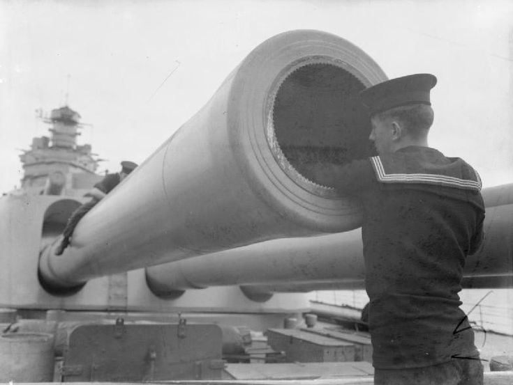 Sailors cleaning one of the 16-inch guns aboard HMS Rodney, Sep 1940