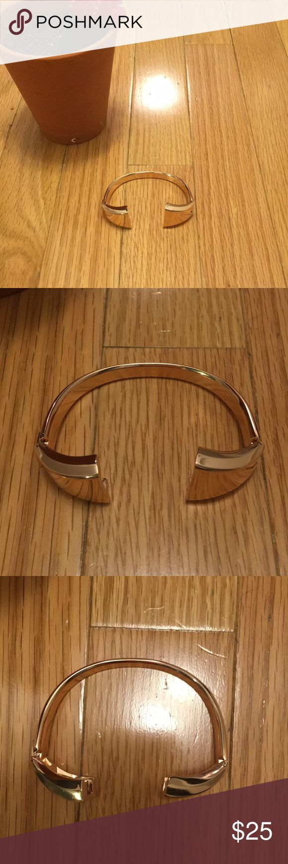 Rose Gold Fitbit Charge 2 Bangle Band Brand new, only tried on. Super cute rose gold Fitbit band which provides a bit of class to a fitness accessory! Bangle shape and it is classy and sturdy. I would recommend for someone with larger wrists. My wrists are super small and it's too big on me. Jewelry Bracelets