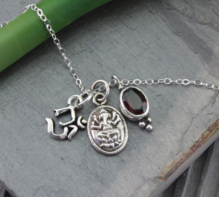 Om, Ganesh, and my birthsone, garnet.  I really really want it!!    Dharmashop.com - Sterling Silver Om Ganesh Necklace, $68.00 (http://www.dharmashop.com/sterling-silver-om-ganesh-necklace/)