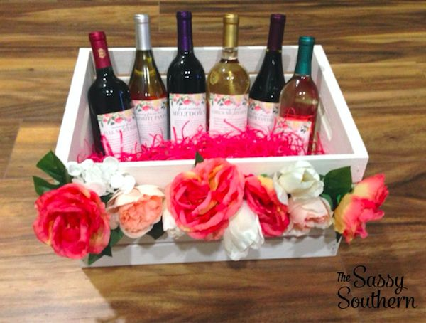 Best baby shower gift ever! Make your favorite mommy-to-be a Mommy Milestones wine crate to celebrate all of her milestones after sweet baby is born! | The Sassy Southern | thesassysouthern.com