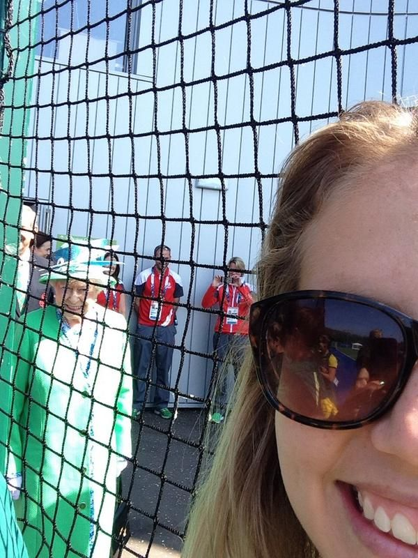 "Ashleigh Nelson taking a selfie with the Queen photobombing through the fence! Ms Nelson said on a blog post she called ""A Queenie Photobomb Kinda Day"": ""Although we take our matches very seriously, sometimes life presents abundant opportunities. Today it was who could get the best selfie with non-other than our very lovely Queen Elizabeth more affectionately known as Queenie"" Ashleigh Nelson Twitter Feed (@nelson_ashleigh)"
