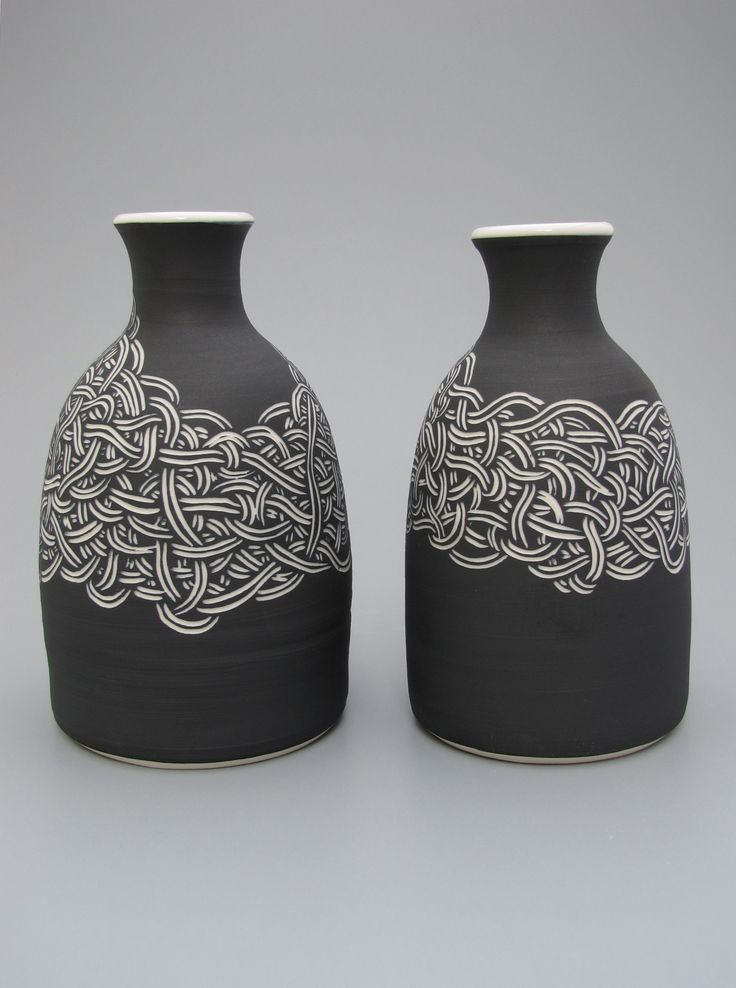 Porcelain knot bottles by Oxide Pottery.