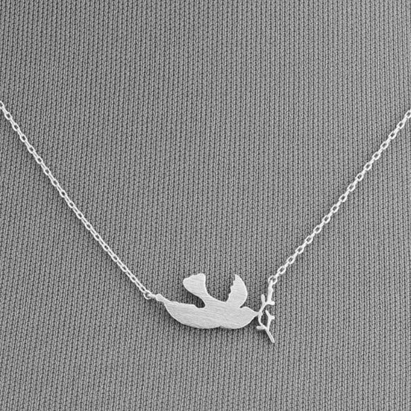 "Dainty Silver Dove Pendant Necklace Dainty Necklace with dove Olive branch. Measures 17"". No extension. It is simple elegance. Main metal is alloy. No stones. Jewelry Necklaces"