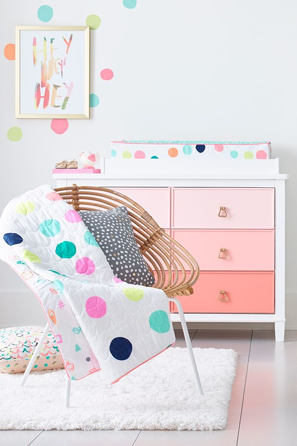 Take a cue from designer, lifestyle expert and blogger Joy Cho, and make your nursery a happy dance of bright and pastel tones. Start with the Oh Joy! Dot Crib Bedding Set, only at Target—it's like cuddling your baby with color. Then, bring the entire room to life with Dot Decals you can add anywhere. Finally, hang the Hey Hey Hey Wall Art for a touch of whimsy.