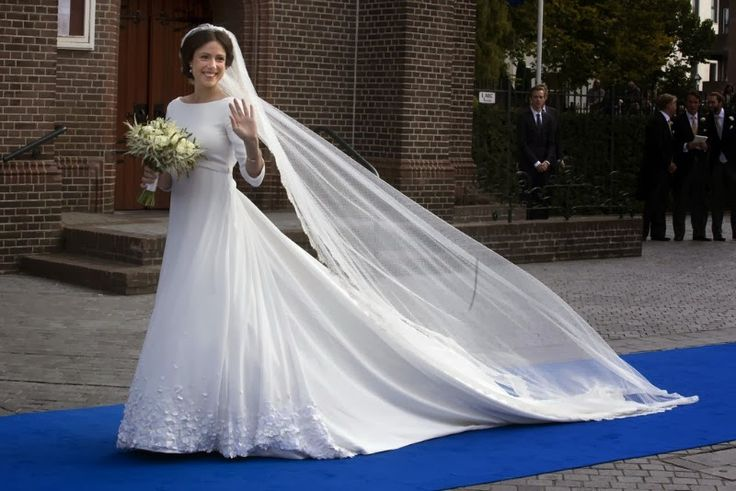 Viktoria Cservenyak arrives at the church today in a stunning full-length gown to marry Prince Jaime, son of Princess Irene and Hugo, Duke of Parma.