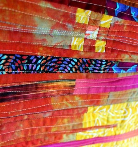 Fractured Sunset–a Project QUILTING Quilt three different variegated colors of @aurifil thread in slightly wavy horizontal lines #aurifil #quilting