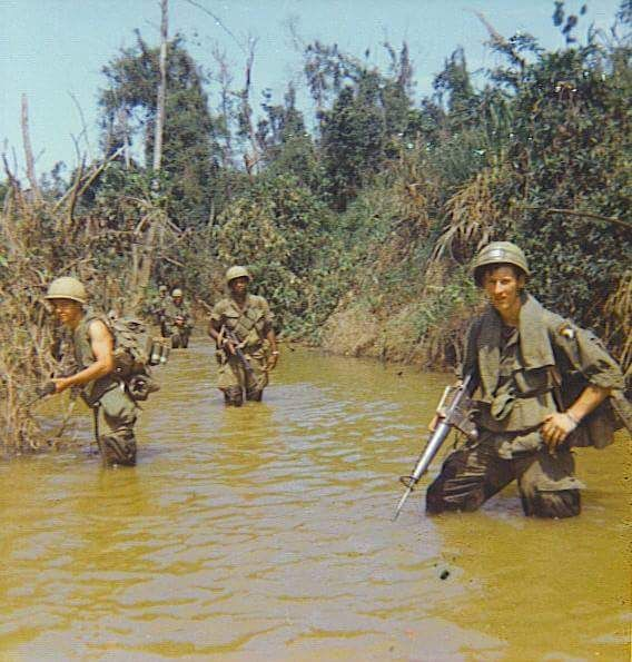 This I think is a photo showing American  soldiers that are on patrol during the Vietnam war. I wonder where they are and who they are looking for?