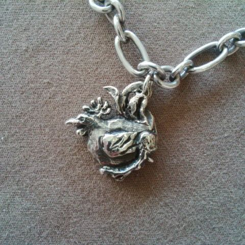 This #Rooster #Chinese #Zodiac was lovingly #handcarved by #Tara Shelton and cast into #sterling silver. Price $165.00 CDN. See more of #artisan Tara Shelton's #jewelry #jewellery at #ArtisansAtWork/ #AAWGallery www.aawgallery.com and www.tarashelton.com
