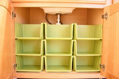 Bathroom Cabinet Organization. Or they would be perfect under the kitchen sink, too. She found these at Dollar General--what a steal :)
