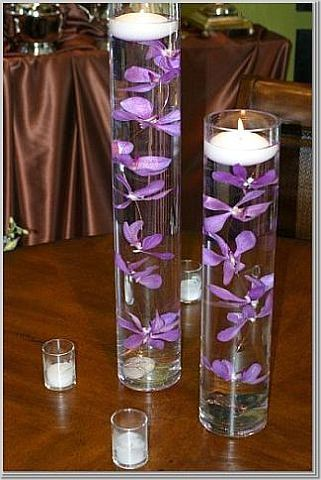 :)Floating Candles, Receptions Tables, Flower Centerpieces, Candles Centerpieces, Wedding Tables Centerpieces, Purple Wedding, Wedding Centerpieces, Tables Decor, Purple Flower