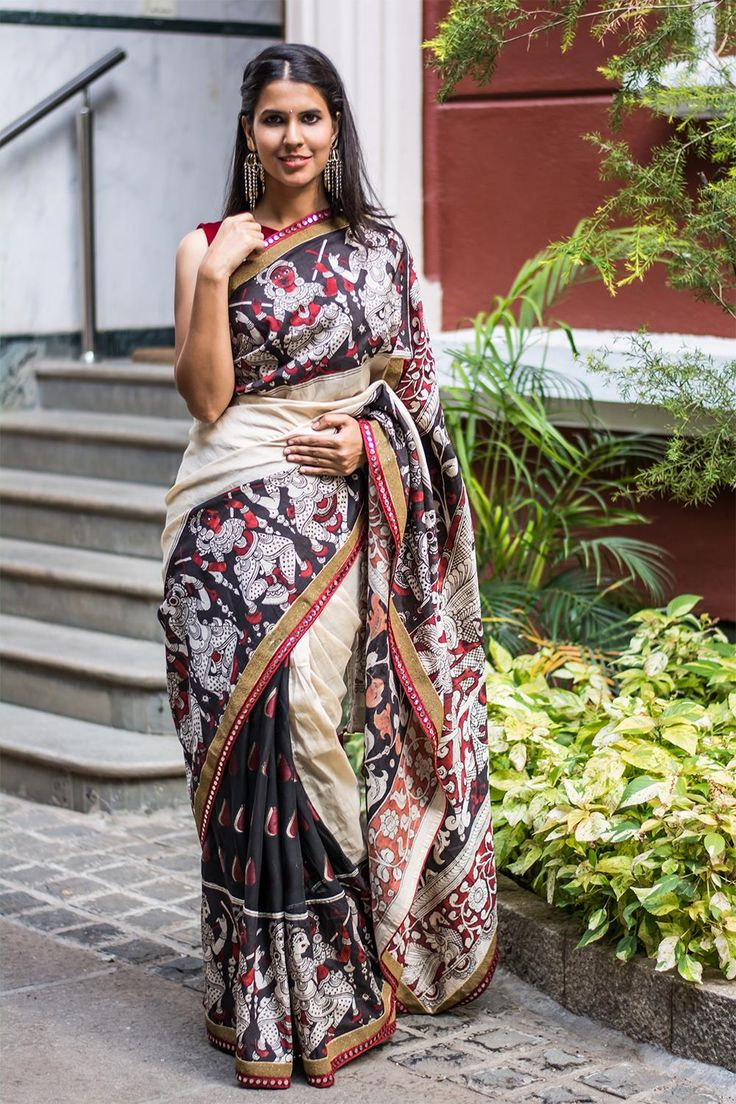A traditional Kalamkari semi crepe saree with Black White and Red border with a surprise printed viscose georgette half! Checkout the maroon mirror work and slim gold edging…Little details make big impact. Truly a Kalamkari with a twist. Dress it up or tone it down with a black or a maroon blouse and yet rock the Kalamkari vibe