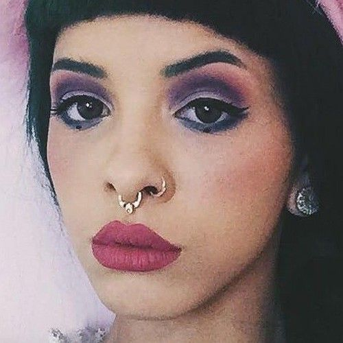 Melanie Martinez wore a colorful makeup in matte shades. Description from…