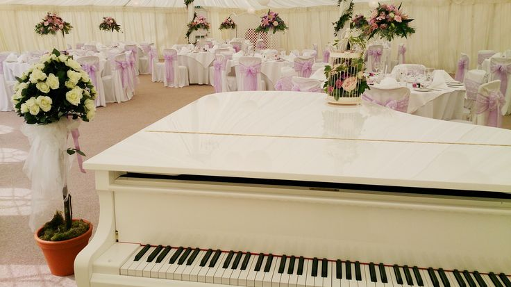 A grand piano in the marquee at Prested Hall http://www.prested.co.uk/weddings/