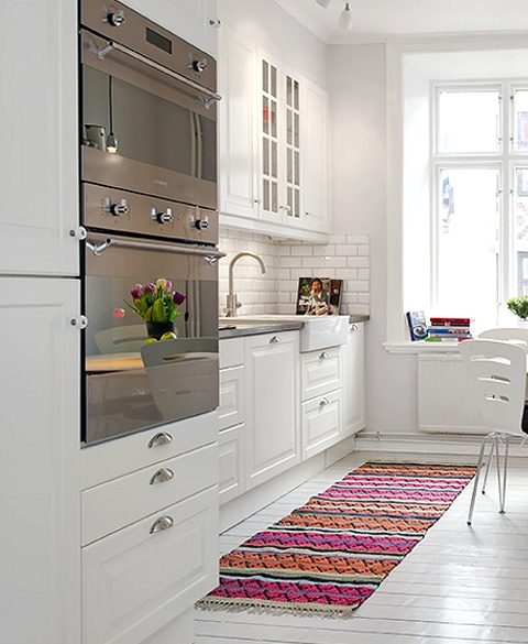 Colour Pop Kitchen.  scandinavian-style-4-white-kitchen-with-colourful-throw rug