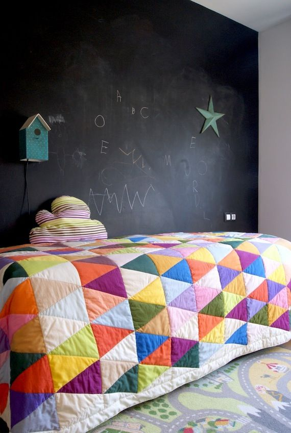 triangle quilt and chalkboard wall