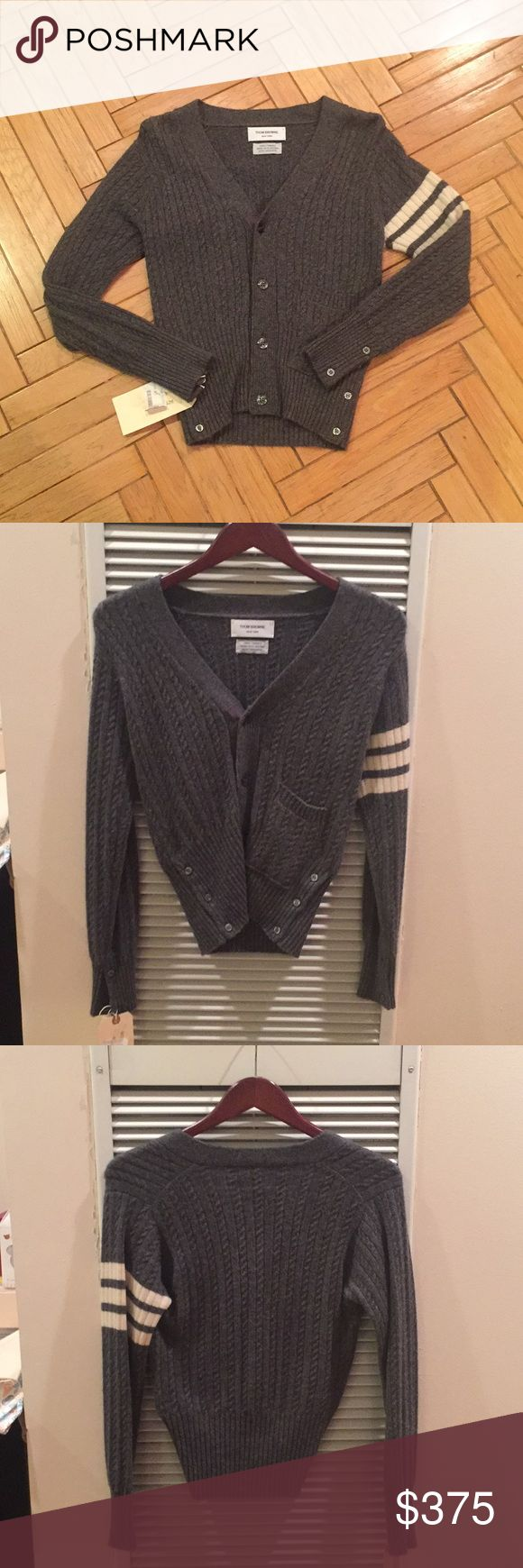 🆕Thom Browne Hand Framed Gray Cashmere Sweater 🆕Thom Browne Hand Framed Gray 100% Cashmere Sweater  Super soft LUXE sweater - the finest cashmere.   Made it in Great Britain   Purchased at a Gilt sample sale. Never worn! This is a steal and 100% authentic!   Last pic of model is for reference of size and look but is not of the actual piece which is reflected in every other photo.   Reasonable offers will be considered. Thom Browne Sweaters Cardigans