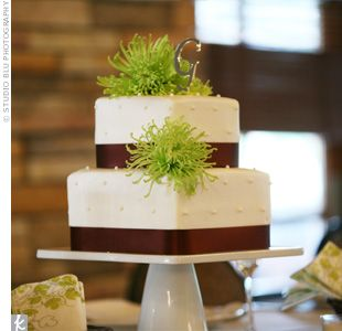 Erin And Troys Square Two Tiered Wedding Cake Was Decorated With Small Dots