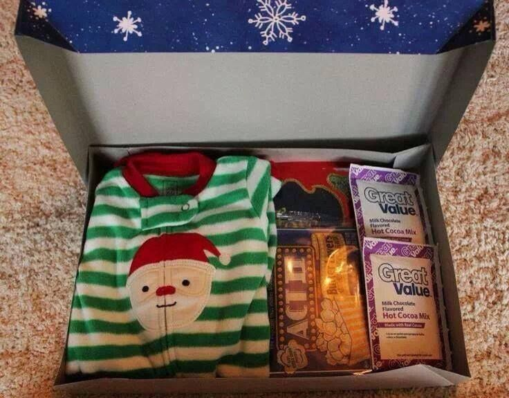I thought this was a super neat idea!!! It's a Christmas Eve box!!! They get new pjs, a Christmas movie, hot chocolate, snacks for the movie, etc!!!