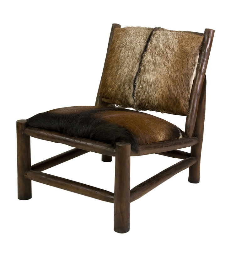 An IMAX exclusive, the Pacino accent chair features authentic animal hide cushions on a solid log frame. Very rustic and charming!