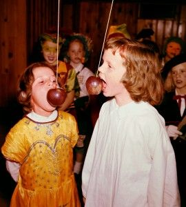 Apple amusement at a #1960s #Halloween party. Love the costumes of the kids in the background!