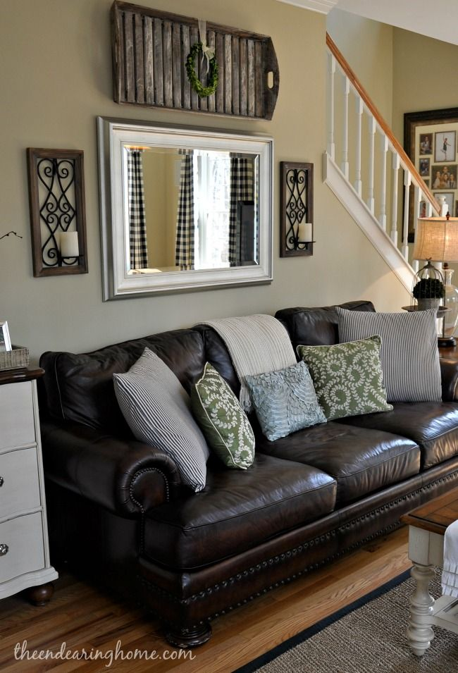 Adding a mirror above the sofa is a great way to create the sense of space in a living room