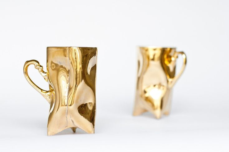 Gold Trident Porcelain Mug, ENDE Ceramics ENDE is an art studio founded by Natalia Gruszecka and Jakub Kwarciński – designers and graduates of ceramics at the Academy of Fine Arts in Wroclaw. A contemporary showstopper, this trident mug is made from porcelain, the hand formed shape made extra alluring with a coating of gold, rich and lustrous. #giftsforhome #gold
